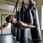 Halle Berry hanging Upside Down from Punching Bag